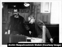 Jiri Hajek (right), who had been Czechoslovakia's foreign minister until his dismissal for speaking out against the 1968 Soviet-led invasion, was photographed as he met with a contact.