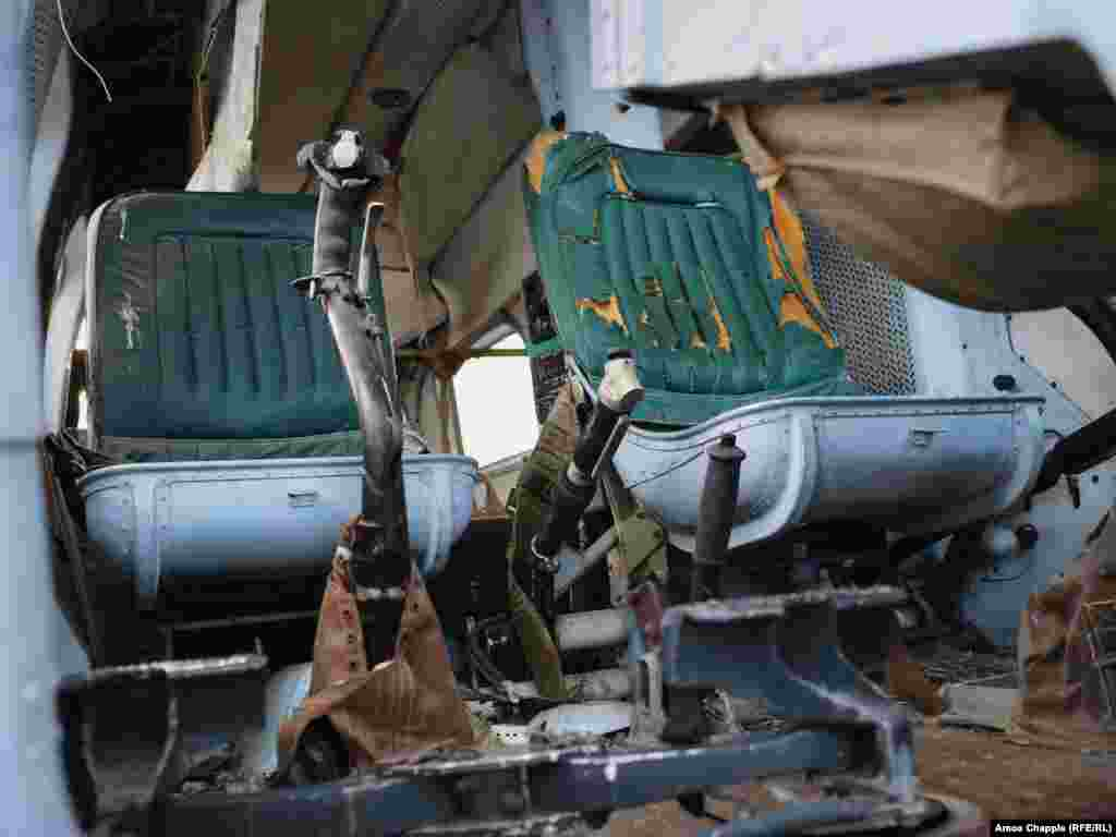 The cockpit of an Mi-2 helicopter in the airfield. The lightly armed helicopters were first flown in 1961, and Mi-2s are probably still in use by the North Korean air force.