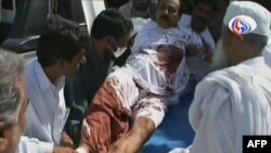 Iran's official Arabic-language Al-Alam TV shows a wounded man arriving at a hospital in the southeastern Iranian city of Pishin, near the border with Pakistan, on October 18.