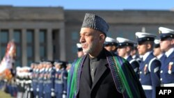 Afghan President Hamid Karzai was honored with a military ceremony outside the Pentagon on January 10.