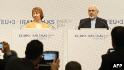EU foreign-policy chief Catherine Ashton and Iranian Foreign Minister Mohammad Javad Zarif give a press statement at P5+1 talks at UN headquarters in Vienna on March 19.