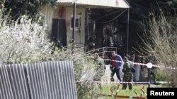 Експерти працюють на місці нападу, 11 квітня 2016 року