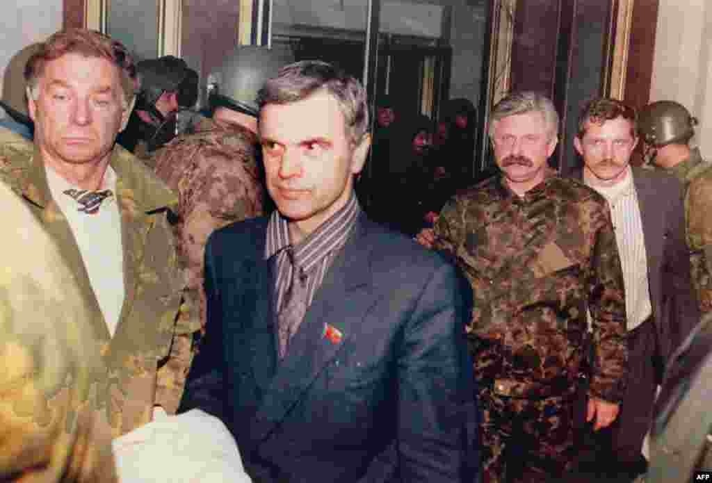 Former parliament chairman Ruslan Khasbulatov (second from left) and former Vice President Aleksandr Rutskoi (third from right) being escorted from the parliament building on October 4.