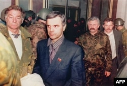 Former Supreme Soviet Chairman Ruslan Khasbulatov (second from left) and former Vice President Aleksandr Rutskoi (third from left) are arrested in Moscow on October 4, 1993.