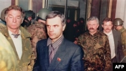 "Russia -- Former Soviet Parliament Chairman Ruslan Khasbulatov (2nd-L) and former Parliament Vice-President Alexander Rutskoi (3rd-R) are guarded by members of ""Team Alpha"" special forces after being arrested, Moscow, 04 October 1993"