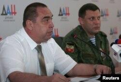Ігор Плотницький та Олександр Захарченко (праворуч), ватажки угруповань «ДНР» і «ЛНР»