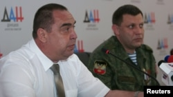 The head of the self-proclaimed Donetsk People's Republic, Aleksandr Zakharchenko, (right) and his Luhansk counterpart, Igor Plotnitsky, attend a press conference in Donetsk in July.