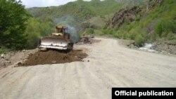 The construction in Kelbajar of a new highway connecting Nagorno-Karabakh to Armenia, 5May2014. (Photo courtesy of the All-Armenian Fund Hayastan.)
