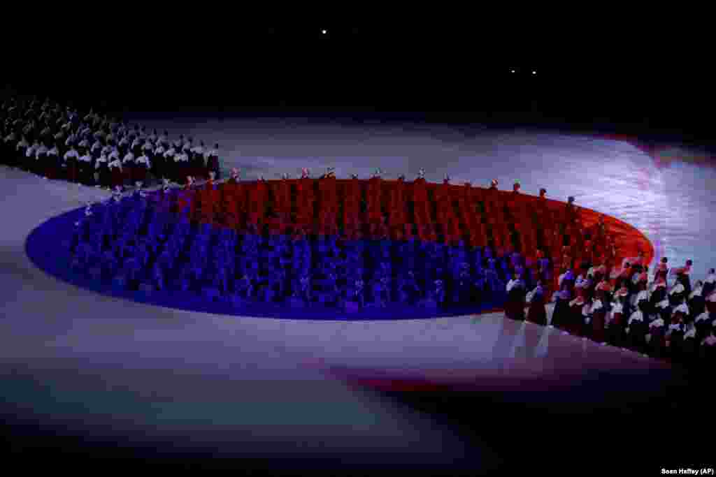 Performers replicate the South Korean flag during the opening ceremony.