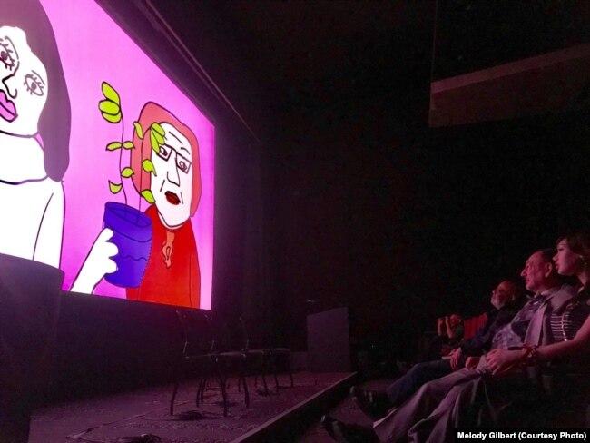 Джон і Джэкі глядзяць фільм на кінафэстывалі ў ЗША