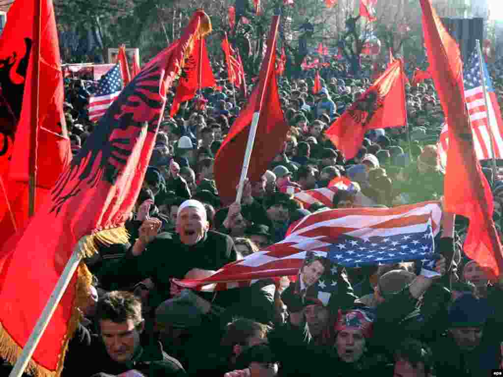 Ethnic Albanians celebrate Kosovo's independence in Pristina. - Kosovar Albanians wave Albanian flags during independence celebrations in Pristina, Kosovo, on February 17, after Kosovo's parliament proclaimed independence from Serbia.