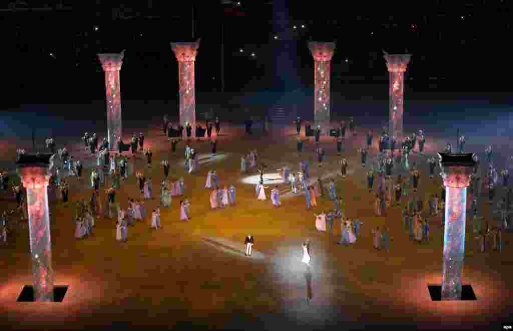 Giant columns columns rise from trap doors in the stadium floor