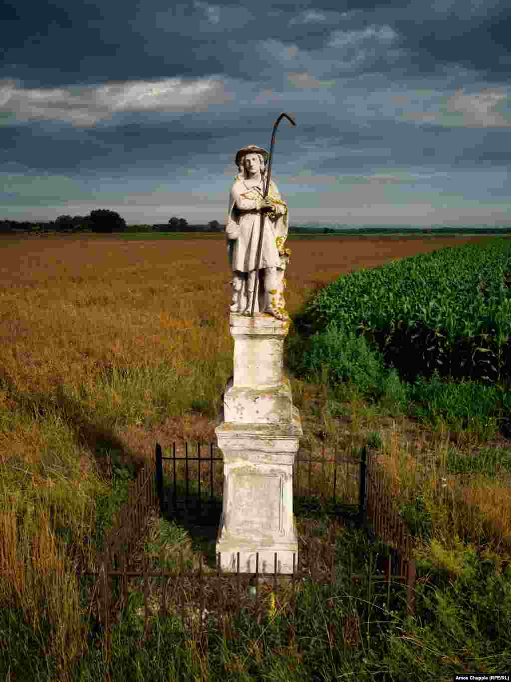 A roadside monument to St. Wendelin, the patron saint of shepherds, stands near Sumeg in western Hungary.