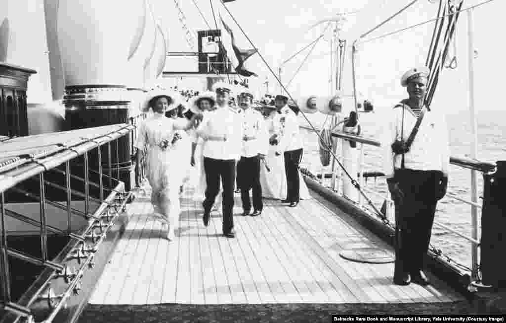The grand duchesses striding across the deck of the Standart. Life on board the yacht was relaxed and informal, and flirtations sprang up between the sailors and the grand duchesses.