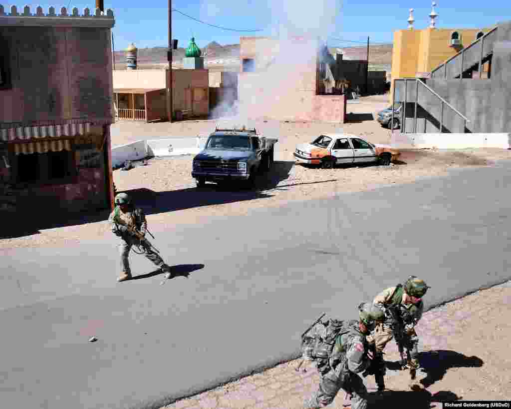 National guard soldiers react to a simulated car bombing in Medina Jabal.