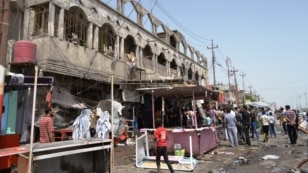 The aftermath of a bomb attack in the southern Iraqi city of Basra on May 20.