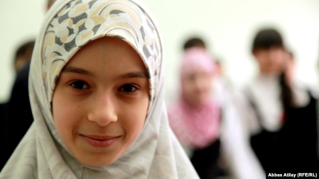 A girl wearing hijab at a school in the republic of Daghestan.