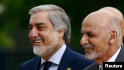 Afghanistan's President Ashraf Ghani, right, is pictured next to Afghanistan's Chief Executive Abdullah Abdullah as they arrive for the NATO Summit in Warsaw, Poland on July 9.
