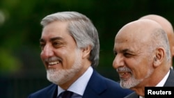 Afghanistan's President Ashraf Ghani (right) with the country's Chief Executive Abdullah Abdullah (file photo)