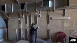 Эксперт Организации по запрещению химического оружия на объекте в Сирии, 10 октября 2013 года. Иллюстративное фото.