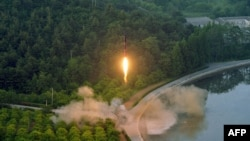 North Korea test-fires a ballistic missile at an undisclosed location on May 28.