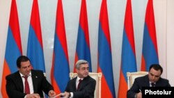 Armenia - President Serzh Sarkisian (C), Prosperous Armenia Party leader Gagik Tsarukian (L) and Oriants Yerkir Party leader Artur Baghdasarian sign a joint declaration in Yerevan, 17Feb2011.