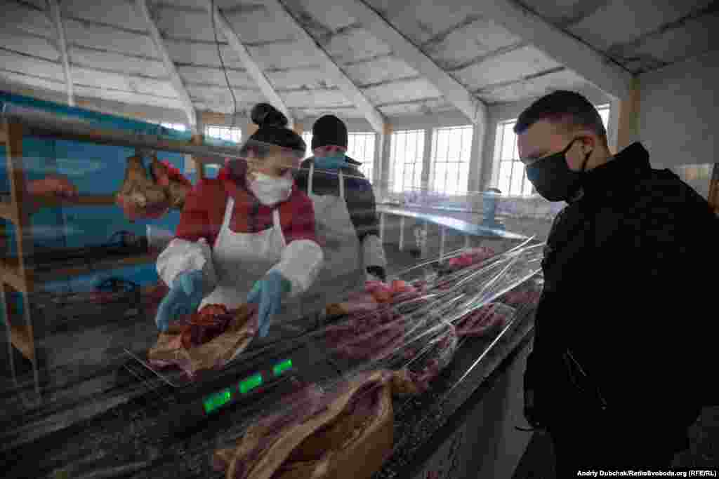 """At a butcher's shop, residents of Kalynivka told RFE/RL that the Ukrainian government was providing financial support to some workers until April 26. """"What comes next is unknown,"""" one worried resident said."""