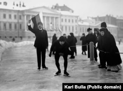 An ice-skater waits for the starting call in a race in St. Petersburg in the early 1900s.