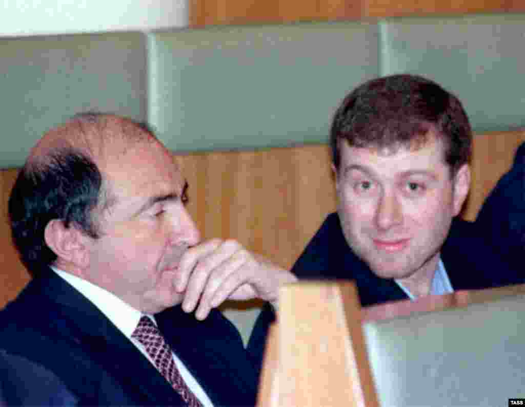Oil and media tycoon Boris Berezovsky (left) with his fellow oligarch Roman Abramovich at a meeting of Duma deputies in December 1999. In 2012, Berezovsky lost a $5.1 billion lawsuit against Abramovich in a dispute over shares in the oil firm Sibneft.