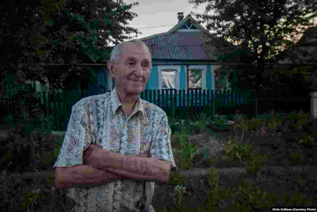 "Nikolai Ivanovich, an 86-year-old pensioner, stands outside his home in the town of Myrnohrad. He said his pension was not enough, and prices were on the rise. ""I had to sell my car because my pension was too low. That's how we live now."""