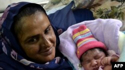 Pakistani gang-rape survivor and activist Mukhtar Mai and her son, pictured here in November 2011, will attend the meeting.