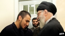 Iranian supreme leader Ayatollah Ali Khamenei (R) greets Jihad Mughniyeh (L), the son of slain Hezbollah top commander Imad Mughniyeh, at Khamanei's residence in Tehran, undated