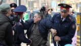 KAZAKHSTAN -- Police officers detain an anti-government protester during a rally in Almaty, Kazakhstan March 22, 2019.