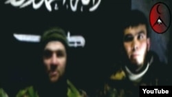 Russia -- Doku Umarov (L) and Ingushetia resident Magomed Yevloyev (R) speaks in a video message, undated