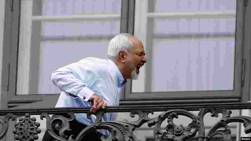 Iranian Foreign Minister Javad Zarif enjoys a lighter moment during talks in Vienna with world powers over Tehran's nuclear program that ended in a breakthrough agreement on July 14. (Reuters/Leonhard Foeger)