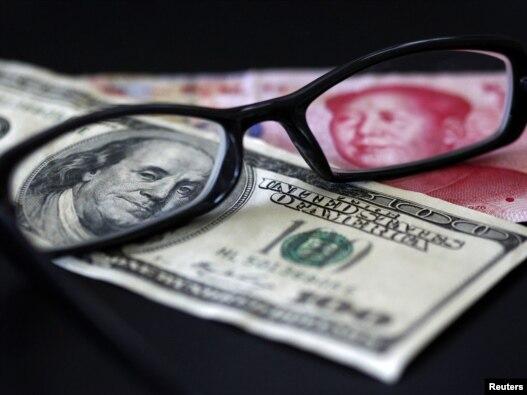 Dolari i juani - ilustrativna fotografija