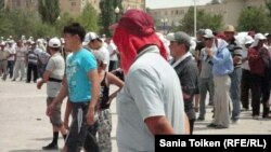 Striking Kazakh oil workers and their families at a rally in July
