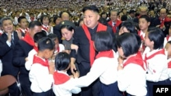 North Korea -- Leader Kim Jong-Un (C) at a concert to celebrate the 66th anniversary of the Korean Children's Union (KCU) organizations in Pyongyang, 06Jun2012