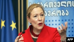 """The EU's Benita Ferrero-Waldner speaks at a press conference in Tbilisi on January 20. """"There are many, many things that still are missing,"""" she said."""