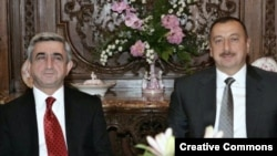 Armenian and Azerbaijani Presidents Serzh Sarkisian (left) and Ilham Aliyev during their meeting in Prague on May 7
