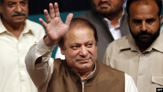 Pakistan's incoming prime minister, Nawaz Sharif, waves to his party's newly elected MPs in Lahore on May 20.