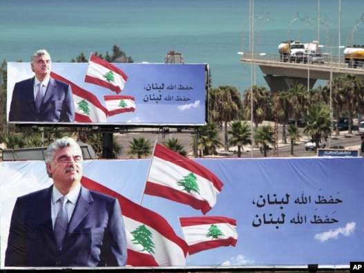 Billboards show assassinated Lebanese former Prime Minister Rafik Hariri on the highway in the southern port city of Sidon.