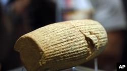 The Cyrus Cylinder is seen at the National Museum of Iran, in Tehran, Sunday, Sept. 12, 2010.