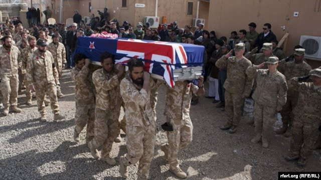 Soldiers carry the coffins of two New Zealand soldiers killed in Banyan Province in a battle with Taliban insurgents.