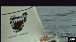 """A TV grab shows the """"Kingdom of Bahrain"""" racing yacht, on which the five British men were traveling."""
