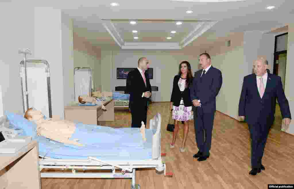 Aliyev's public appearances have been largely limited to ribbon-cutting ceremonies at public buildings, many of which have undergone recent renovations paid for by the presidential reserve fund. Aliyev and his wife visit the opening of a new hospital in Baku on September 12 -- with mannequins standing in as makeshift patients.