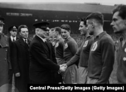 British Labour Party politician Albert Victor Alexander greets members of the Dynamo Moscow team before their game against Chelsea at Stamford Bridge.