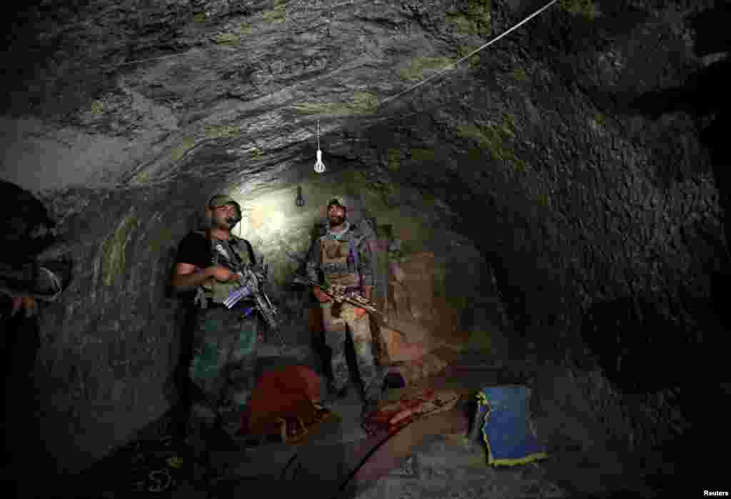 Afghan Special Forces inspect a cave that was used by suspected Islamic State militants at the site where the United States dropped its largest nonnuclear bomb earlier this month in the Achin district of the eastern province of Nangarhar. (Reuters/Parwiz)