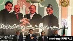 Officials from Turkmenistan, Afghanistan, Pakistan, and India meet at a TAPI project meeting in Herat, Afghanistan, in April, posing in front of a poster of the leaders of their countries.