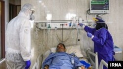 Nurses caring for coronavirus patients in a hospital in Iran. May 14, 2020